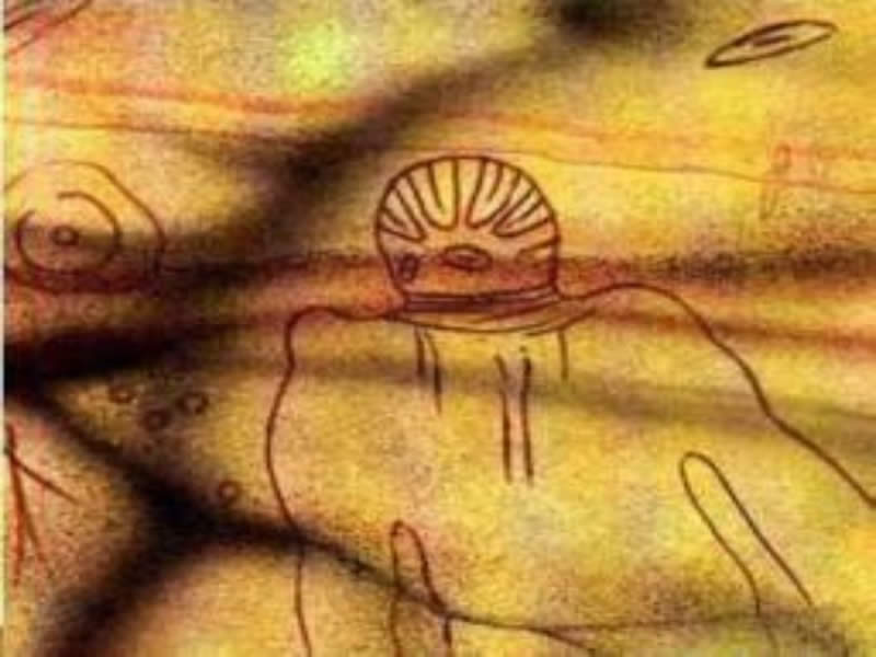 6,000 year old ancient cave painting from Tassili in the Sahara desert of North Africa, showing a being with what appears to be a spacesuit helmet.